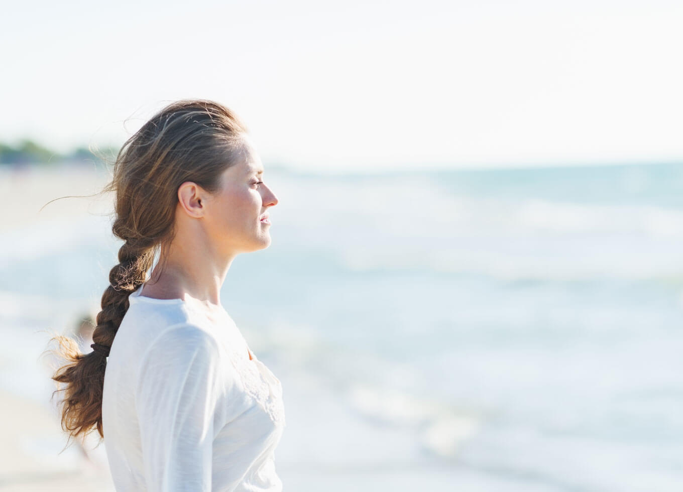 Woman looking out to ocean